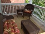 Relax on the rear deck overlooking the flagstone patio and garden
