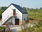 TYN-Y-MYNYDD BACH, romantic, country holiday cottage, with open fire in Halkyn, Ref 8422