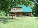 Possum Lodge luxury cabin vacation home on 64 acres, pet friendly, sleeps 2-8, fully furnished.