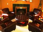 Intimate gatherings on the leather chairs in the den by the fireplace.