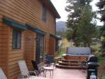 Back porch with gas grill, private hot tub, and 5 chairs/2 loungers