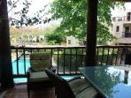 Main porch overlooks swimming pool.