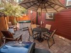 A private back patio with your own hot tub, BBQ and . . . exhale
