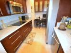 Renovated kitchen with granite, wooden cabinets, top-notch new appliances