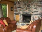 stone fireplace, comfy leather couches