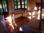 lower bedroom sunny and bright with queen size bed and wardrobe, view of volcano and garden