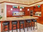L509 Sandcastles Suite Spacious Gourmet Kitchen with Five Bar Stools and an Indoor Dining Table Seating Eight Guests...