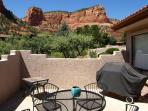 Patio with gas grill showcases the views of Castle Rock