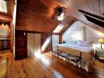 Natural Woods Surround You In This King Size Bed Master Suite Complete With En Suite and Ceiling Fan
