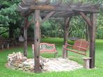 Reclaimed barn beam pergola for campfires.  Wood provided free of charge
