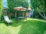 Large gated yard w/gas grill. Stairs leading up to sun deck and apt. entrance