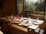 Dining table with huge windows overlooking the property