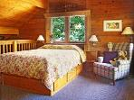 Our chalet cabin offers an upstairs open loft bedroom and queen bed..lots of ceiling height.