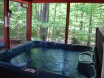 Hot Tub  with beautiful view and access to open deck and interior dressing and laundry rooms