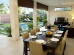 Dining and Living Area overlooking privately fenced pool