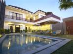 View of Frameless Glass Pool fence and private villa building