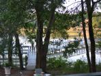 Backyard is a private peninsula waterfront with dock. Creek to the right / River to the left.