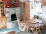 Hearth Fireplace in the kitchen gathering space