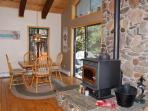 The stone hearth divides the living and dining areas.  This table has leaves and can seat 8.