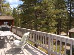 Huge middle floor wraparound deck: BBQ, picnic table, chairs, pine trees, views!