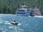 Boating fun on Emerald Bay, you can cruise on the MS Dixie in the background.