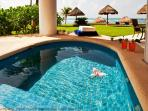 Private jacuzzi on terrace with ocean views