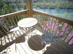 The lower deck offers access to the 8-person hot tub and an amazing lakeview