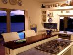 Fully equipped Kitchen with pantry, opens to pool and decks with serve through to outdoor dining.