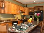 The lovely timber oversized kitchen provides for happy times while preparing a meal.