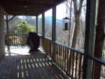 Lower deck BBQ area. Table and chairs creeek view
