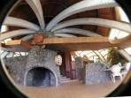 Central fireplace and concrete arches form this unique structure.