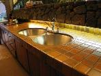 Round stainless steel sinks were an original part of Kellogg's design.