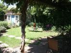 Flagstone patio under wisteria arbor