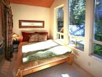 A Lofty Bedroom with Huge Windows Directly Above the Stream