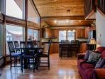 Great room open to dining and kitchen area with views of Table Rock Lake