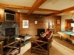 Games area with fireplace, pool table and Murphy Bed