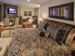 The master suite has it all!  Buffalo Flagstone and Bronze Panel Fireplace, 42' HD LCD TV, Wet Bar!