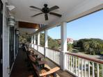 Upper front porch with Amish made gliders. Our favorite morning coffee spot!