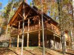 Large Front Porch Features Post Carved From White Pines off the Property
