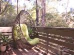 Relax on the treetop front deck...best seat in the house!