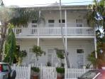 Old Victorian, Key West style building w/ wraparound porch, 2 floors