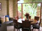 Breakfast nook has hand painted bamboo walls and looks into exotic tropical gardens