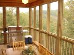 Walk Out Onto A Screened Deck With A Stainless Steel Grill