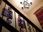 Staircase with art from Thailand and Bhutan - leads to the 3 upstairs bedrooms