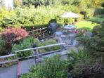 Beautiful park like setting with the soothing sound of the waterfall cascading over the koi pond, surrounded by...