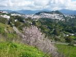 Wonderful spring view of Gaucin in the Sierra De Ronda with almond blossom.