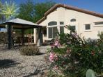 Spacious backyard w/ 3 areas to enjoy:  Gazebo plus covered patio plus tanning/reading lounge area!