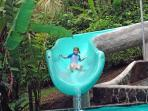 5 yr old enjoying the Waterslide. Fun for all ages. Little people don't go too fast. It's safe!