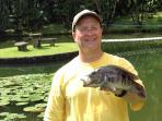 Villa Guest with Bass caught in our backyard pond.. delicious dinner.. YUM!