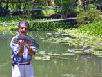 Your Host ~ Glenn showing off a 9 lb Guapote Bass caught in the pond at the villa ~ and released